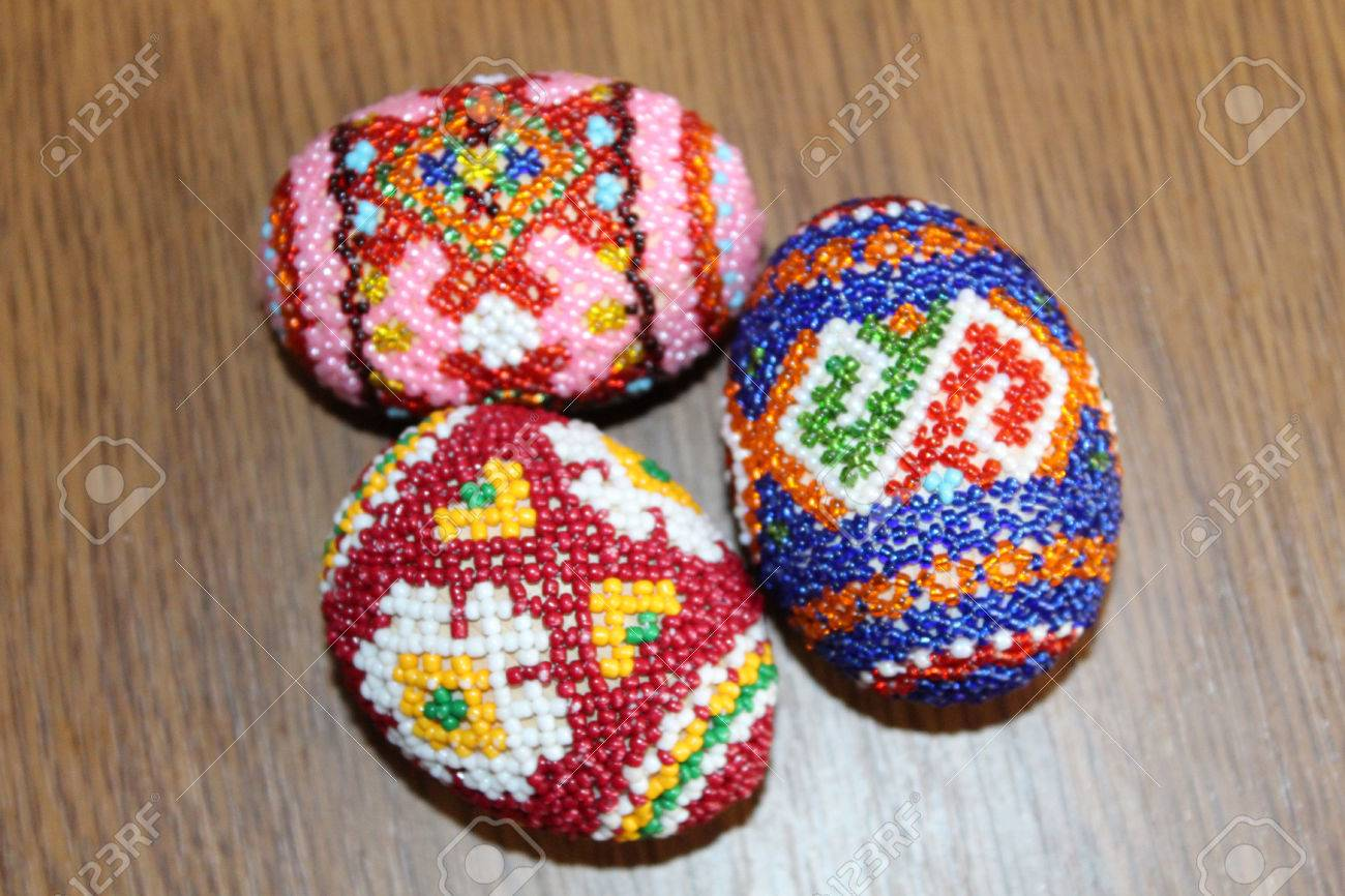 beautiful easter eggs decorated with beads handwork stock photo