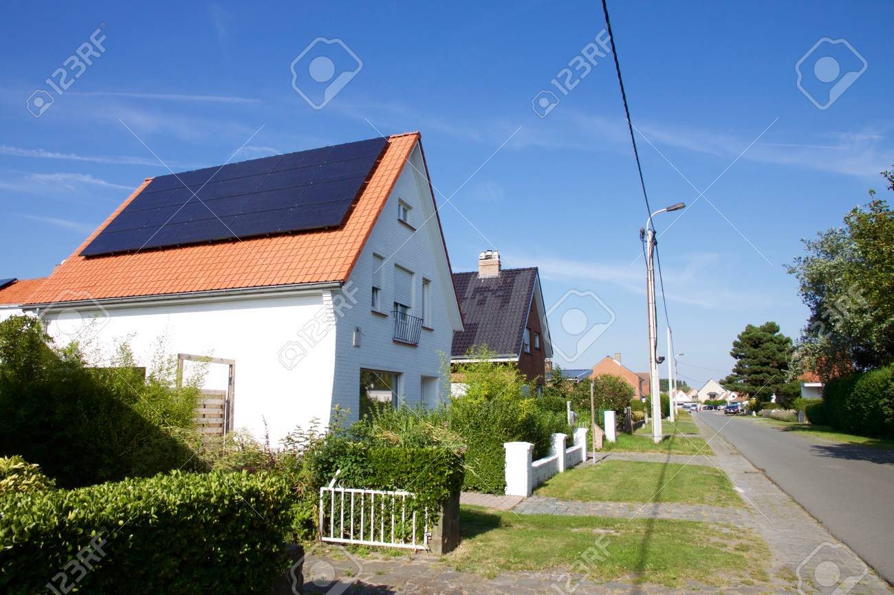 Photovoltaics on the roof of a residential building for alternative energy production - 77370200