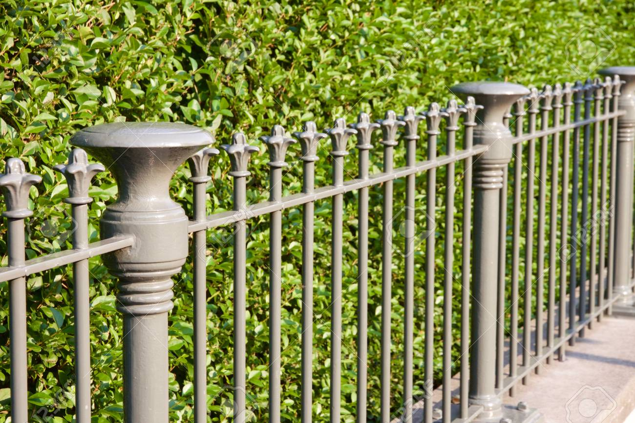 Fence in De Haan, Belgium in front of a green hedge - 78451777