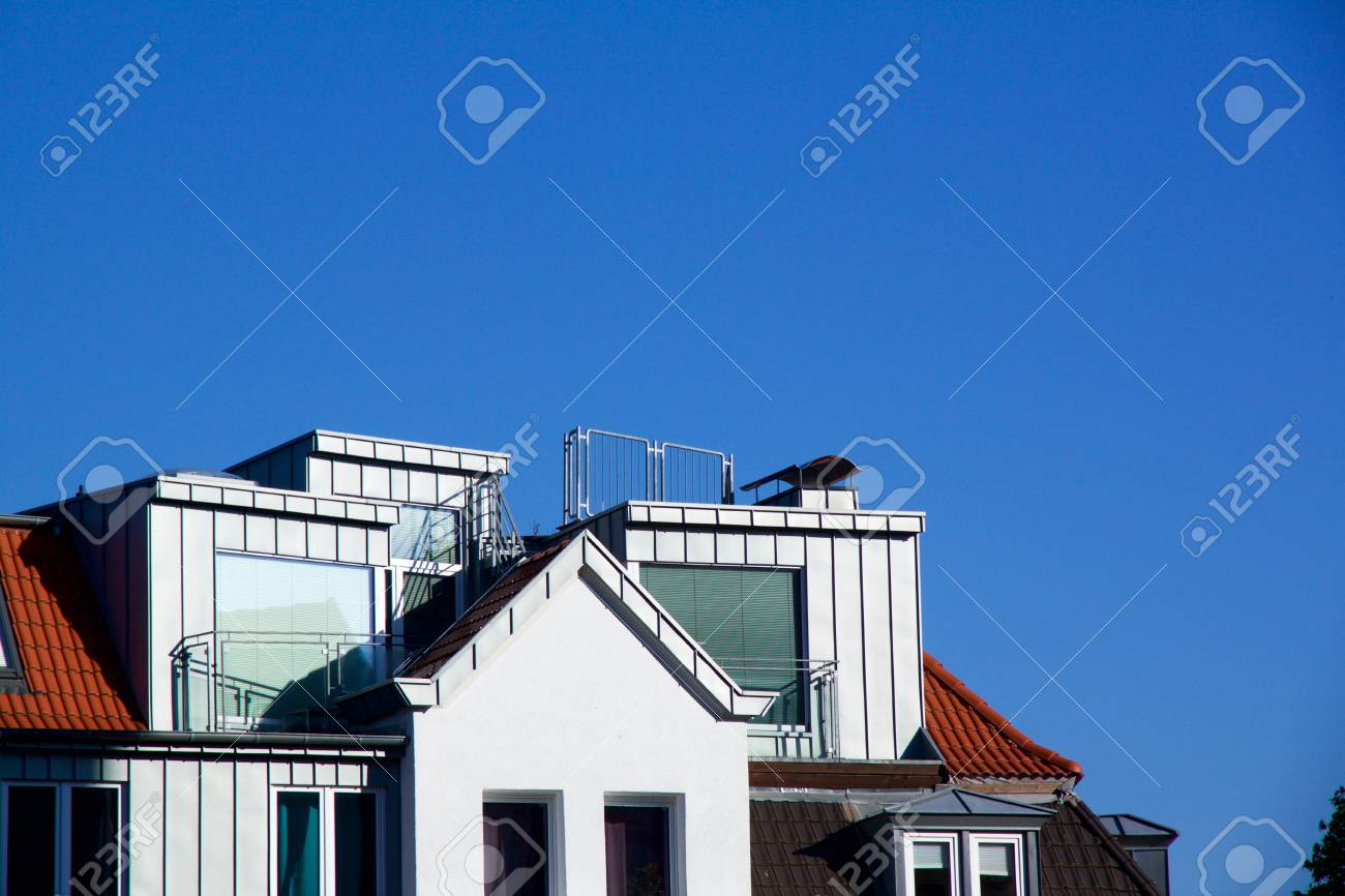 Close-up view on a new construction apartment with dormer windows - 78451787