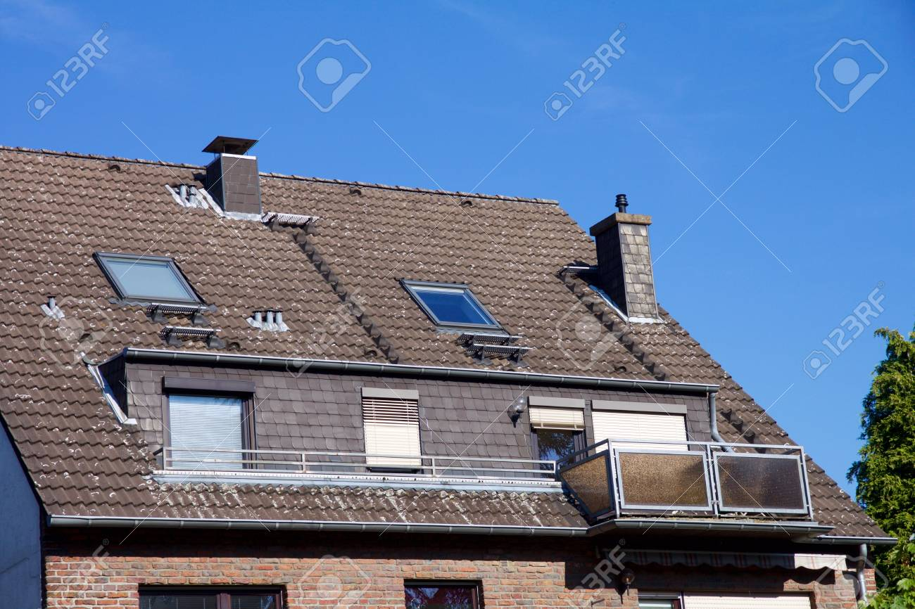 Close-up view on a house with balcony and dormer windows - 79242362