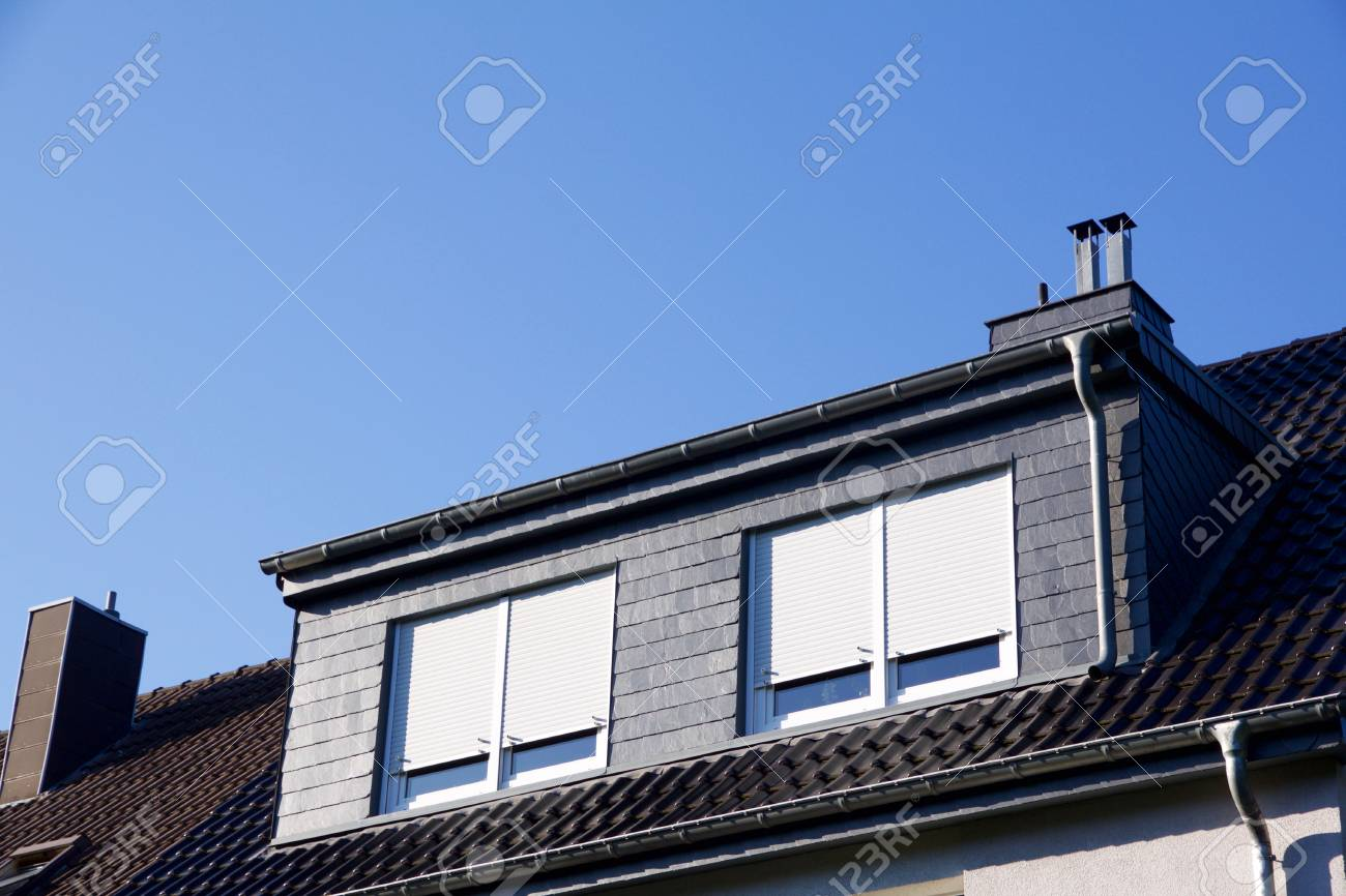Closeup view on a house with dormer windows, shutter down - 78664320