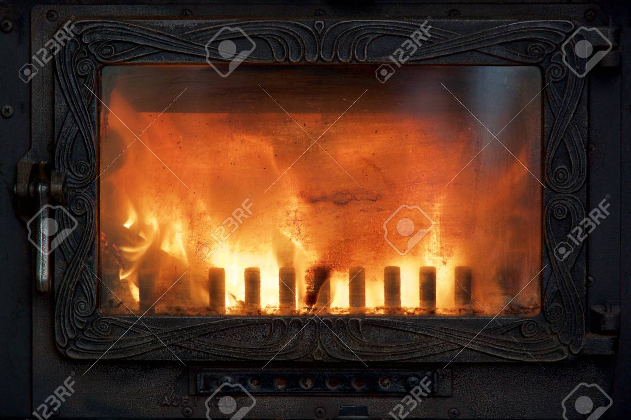 Cozy fire in the stove for a comfortable warm house in winter - 81602220