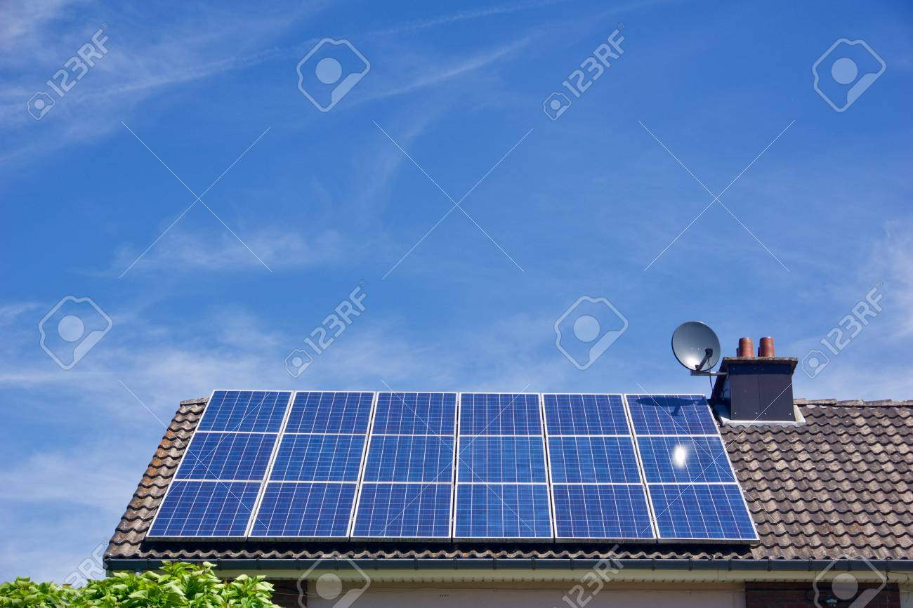 Photovoltaic panels on the roof of a residential building with copyspace - 85551834
