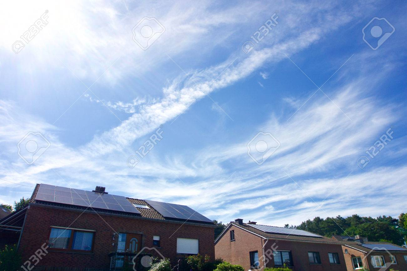 Photovoltaic panels on the roof of a residential building with copyspace - 85551835