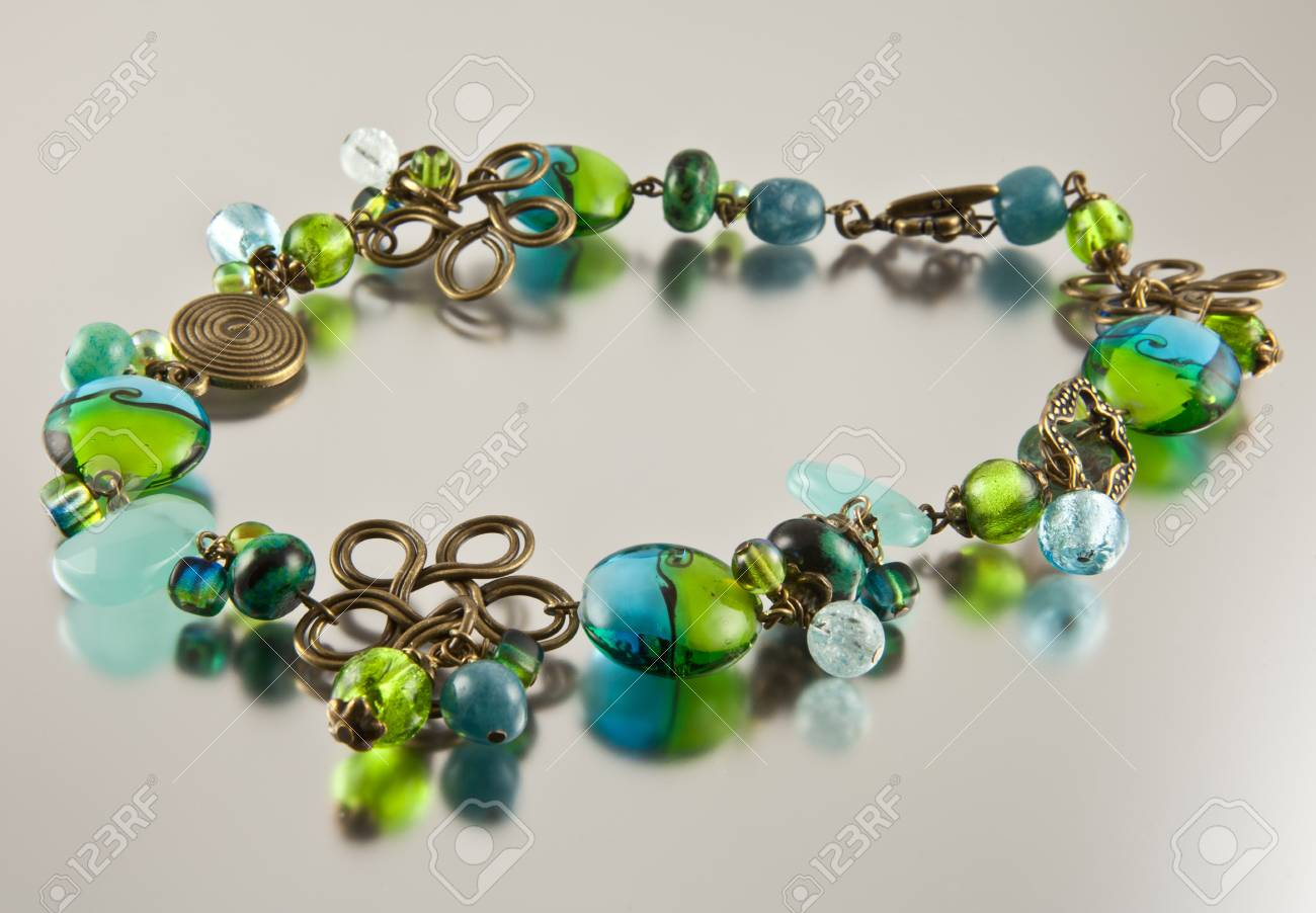 Colorful necklace on silver background Stock Photo - 13678207