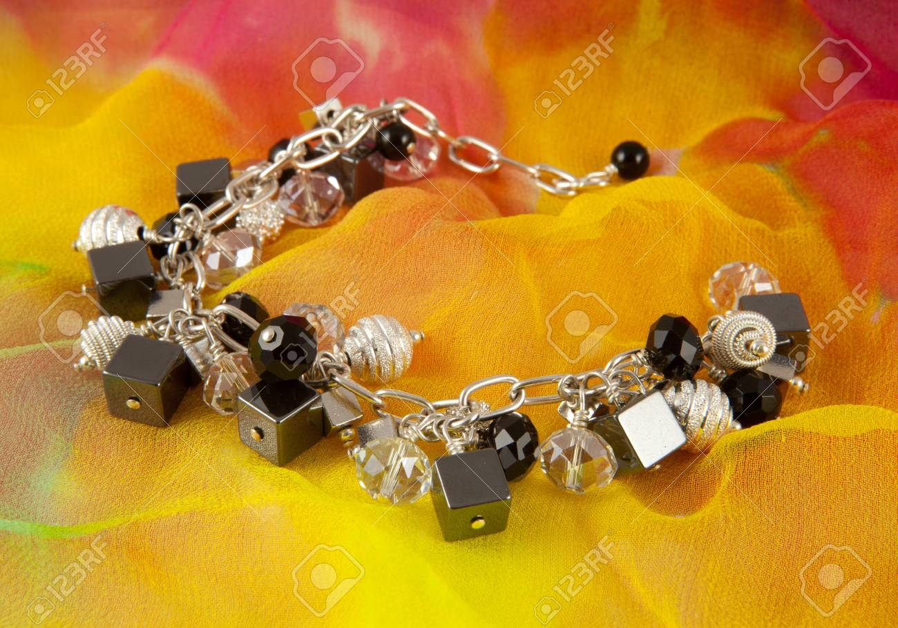 Silver bracelet on colorful background Stock Photo - 13678261