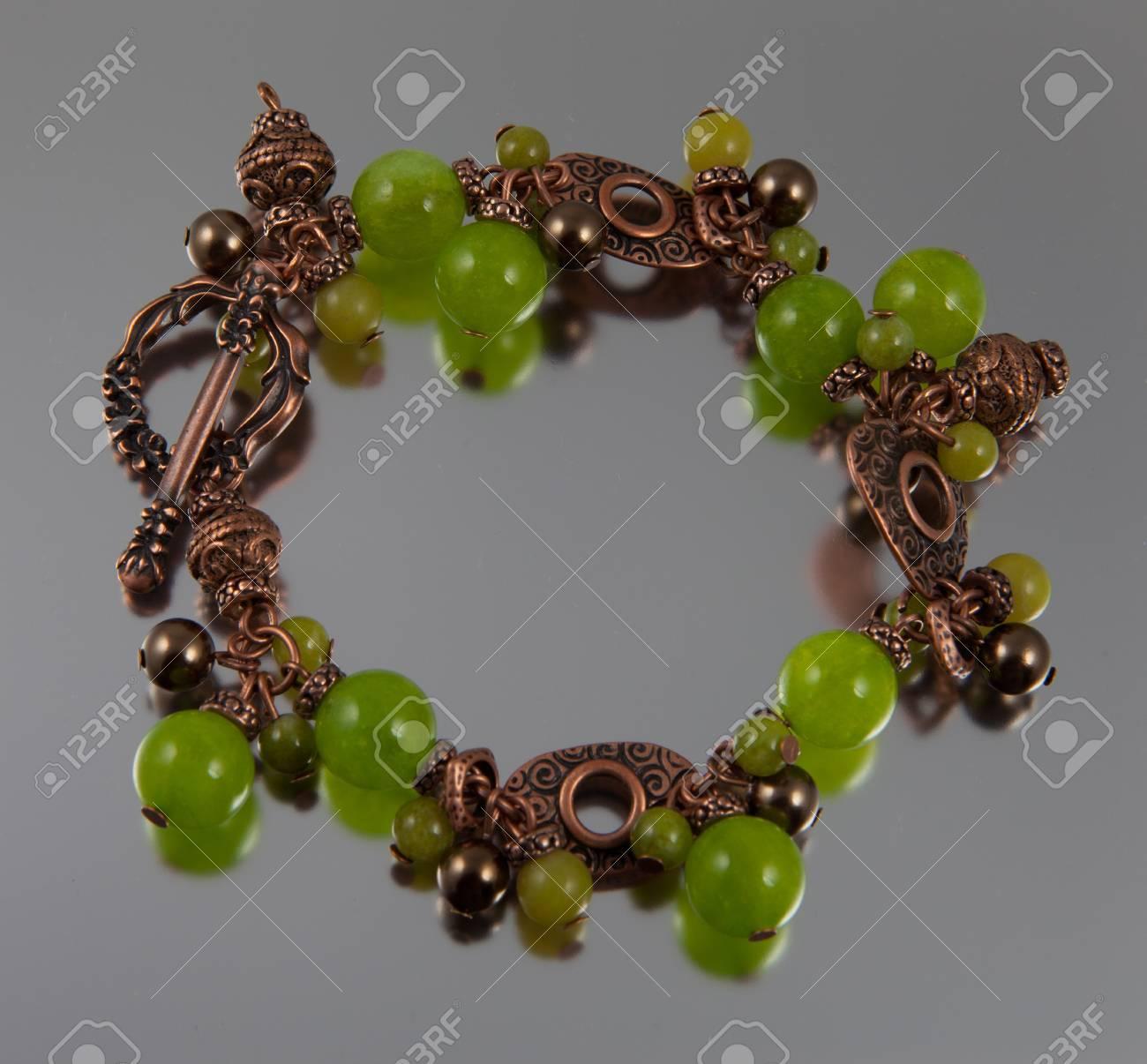Green jade bracelet on silver background Stock Photo - 13678201