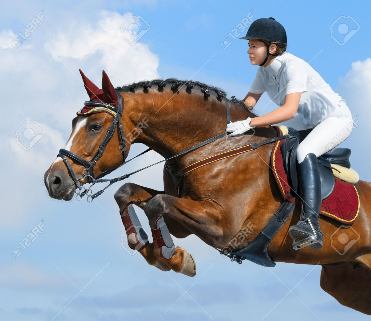 Young woman jumping with bay horse Stock Photo - 9912940