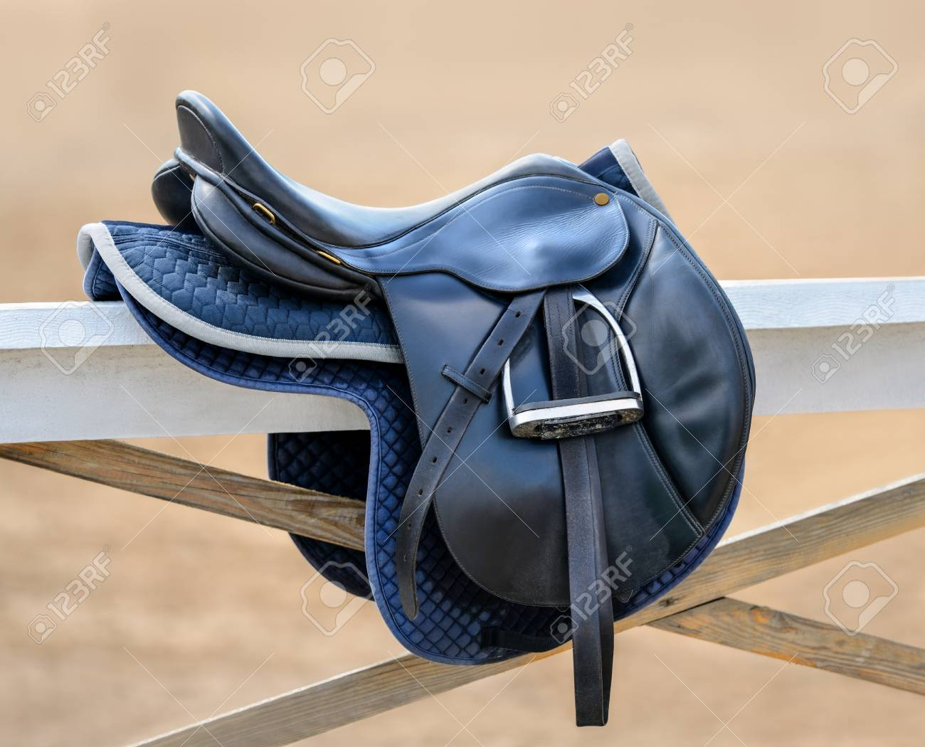 Black English Saddle Hanging On Fence Near Stables Side View Stock Photo Picture And Royalty Free Image Image 96324596