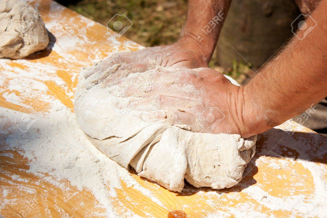 Baker kneading dough made with biological products Stock Photo - 9546300