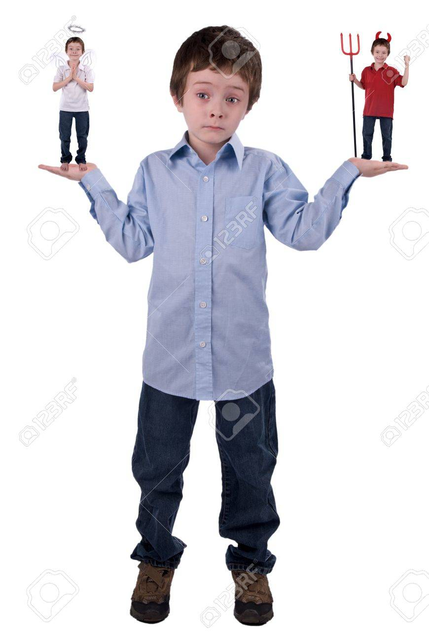 Angel and devil in a young boys hands isolated over white Stock Photo - 2110539