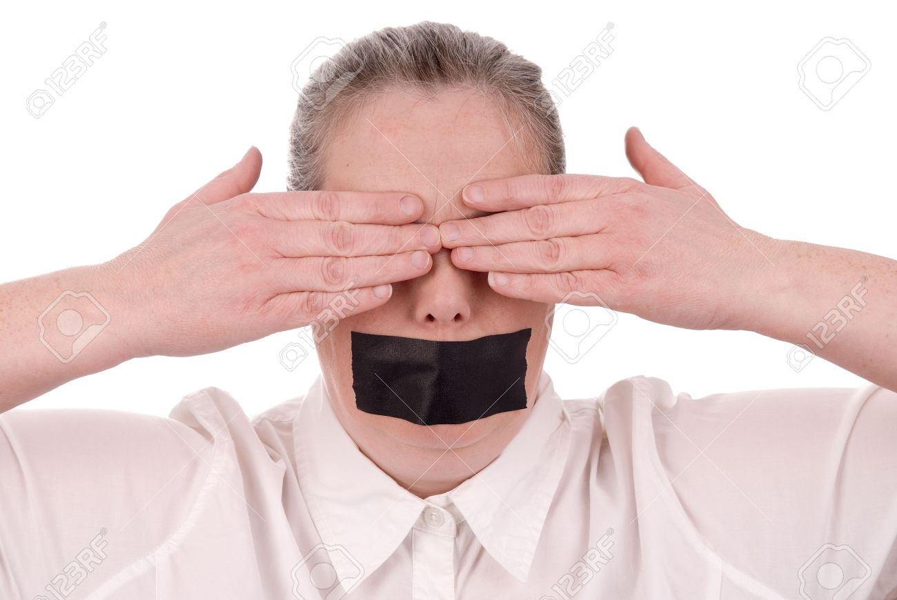 Woman with mouth taped and hands over her eyes closed over a white background Stock Photo - 2534201