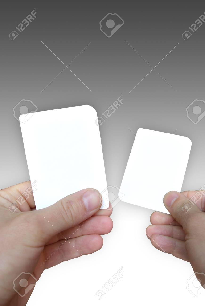 Photo of empty cards in hands on a grey background, to be personalised Stock Photo - 3244238