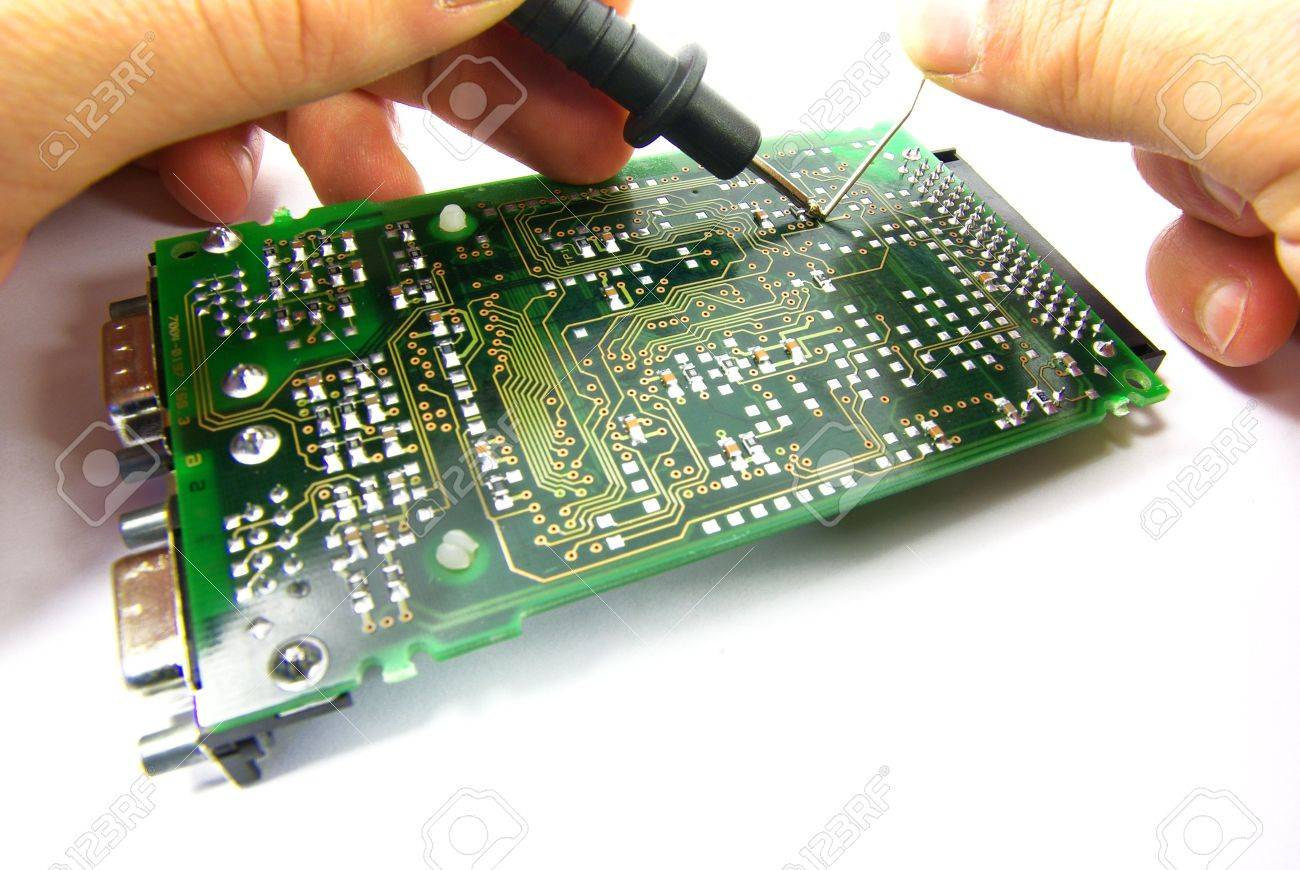 Detail view of a circuit board being repaired. Stock Photo - 3823374
