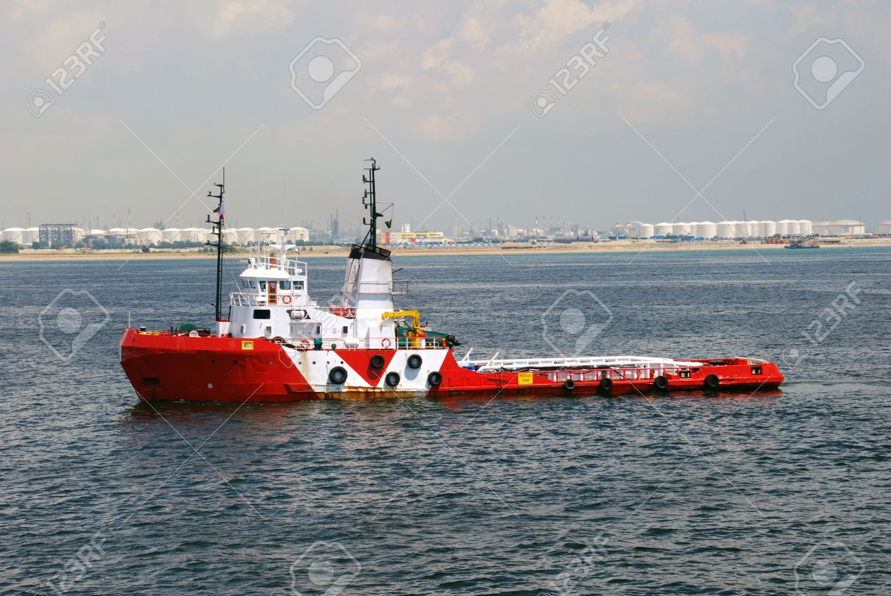 Tug boat towing a barge  Location is Singapore anchorage