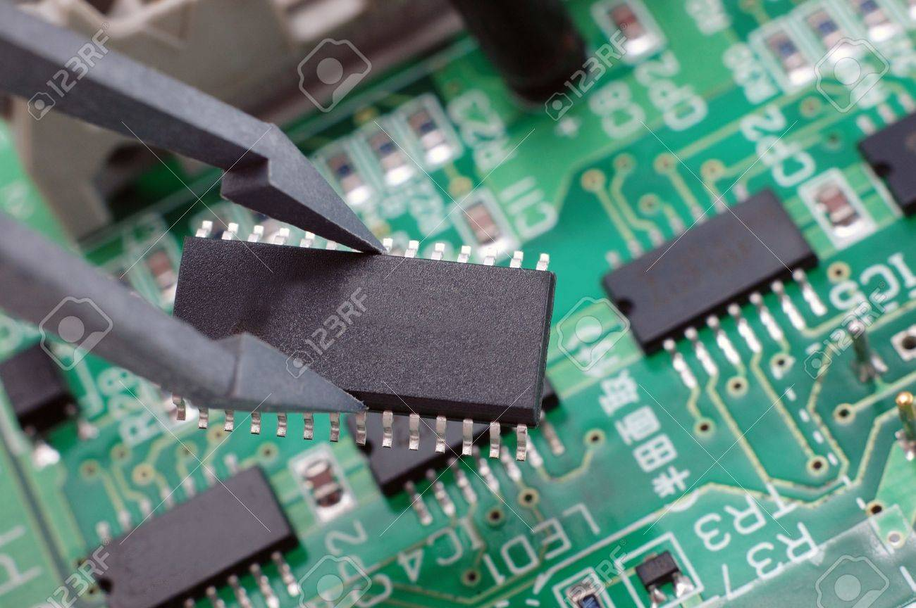 Holding An Integrated Circuit Chip With Printed Board Electronic Royalty Free Stock Image As Back Ground Photo 2064151