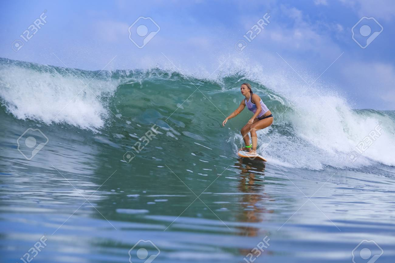 Young woman on blue wave - 125929439