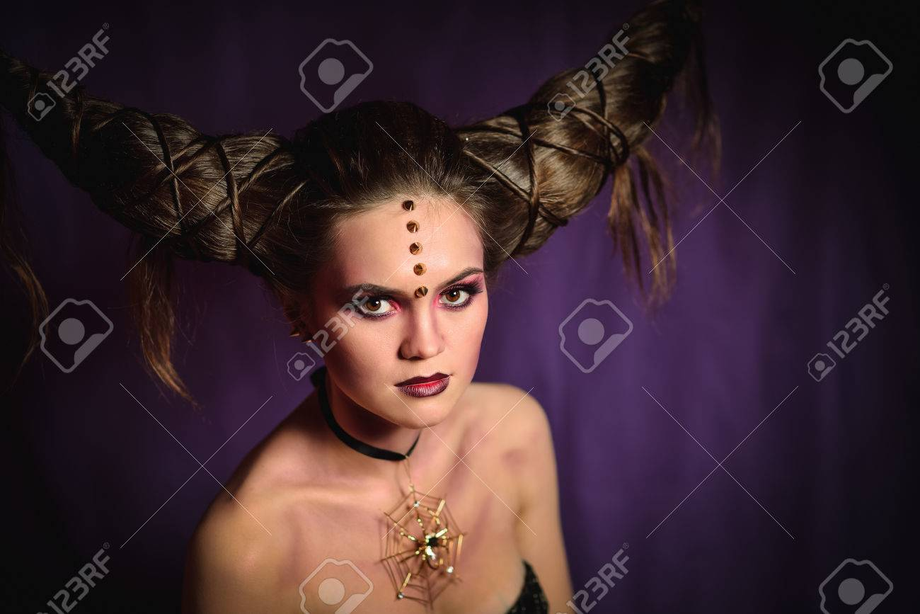 Halloween Makeup Devil.Woman In Halloween Makeup With Hairstyle In Form Of Horns Devil
