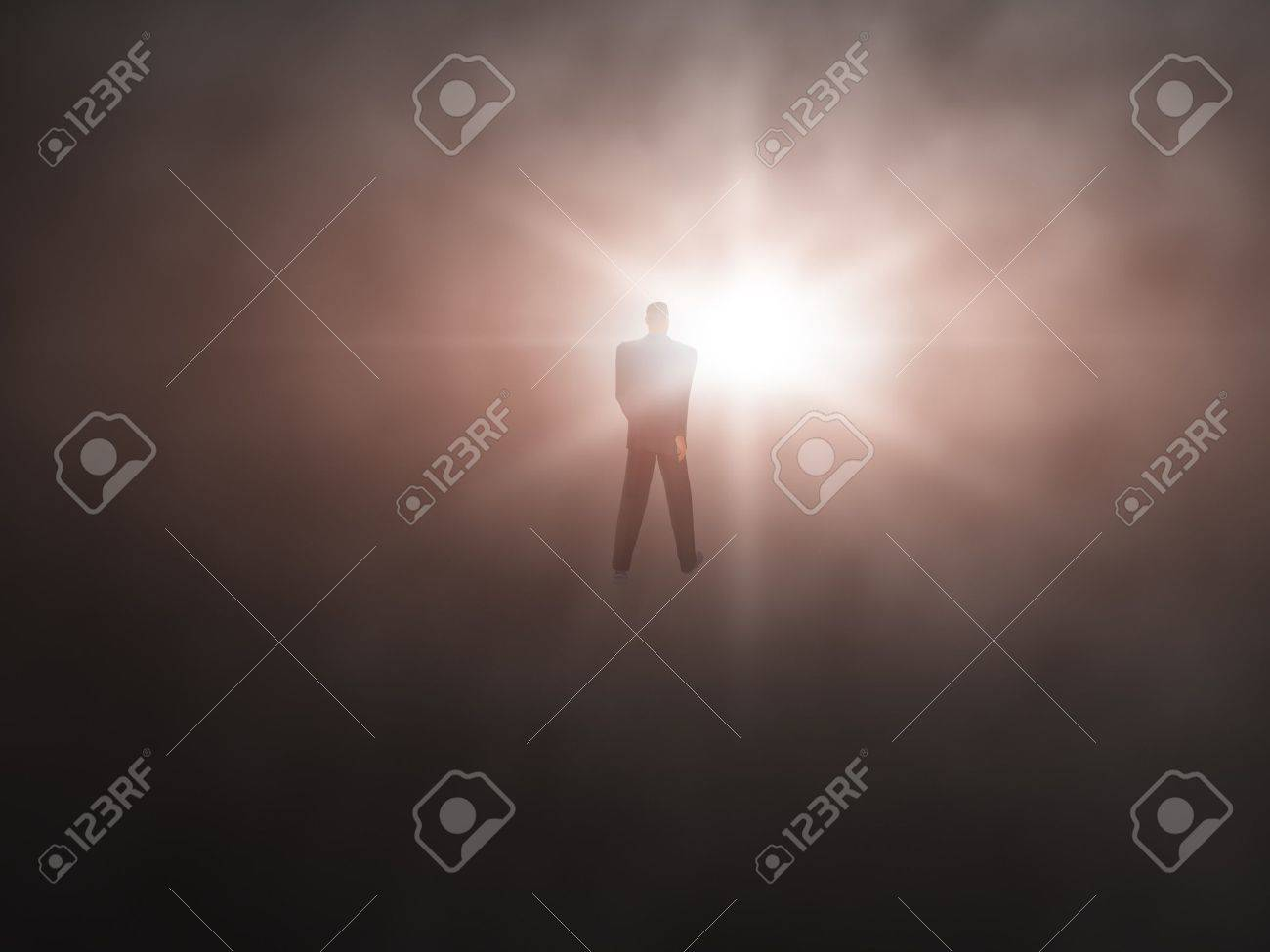 Man Walking From Dark Abyss Into A Bright Light Abstract Stock Photo