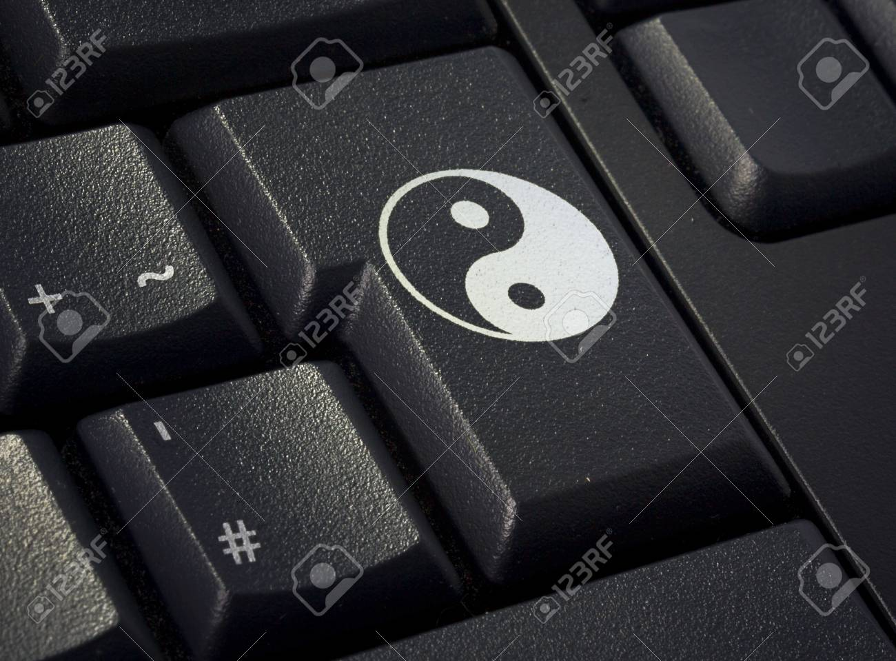 Return Key Of A Black Keyboard With The Shape Of A Ying Yang Stock