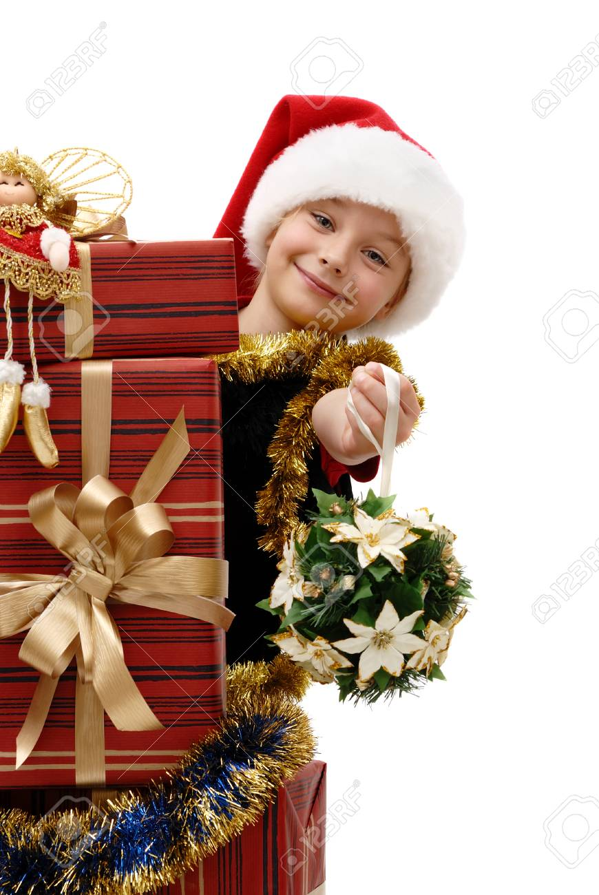 Cute Little Girl In A Santa Claus Cap With Christmas Gifts On ...