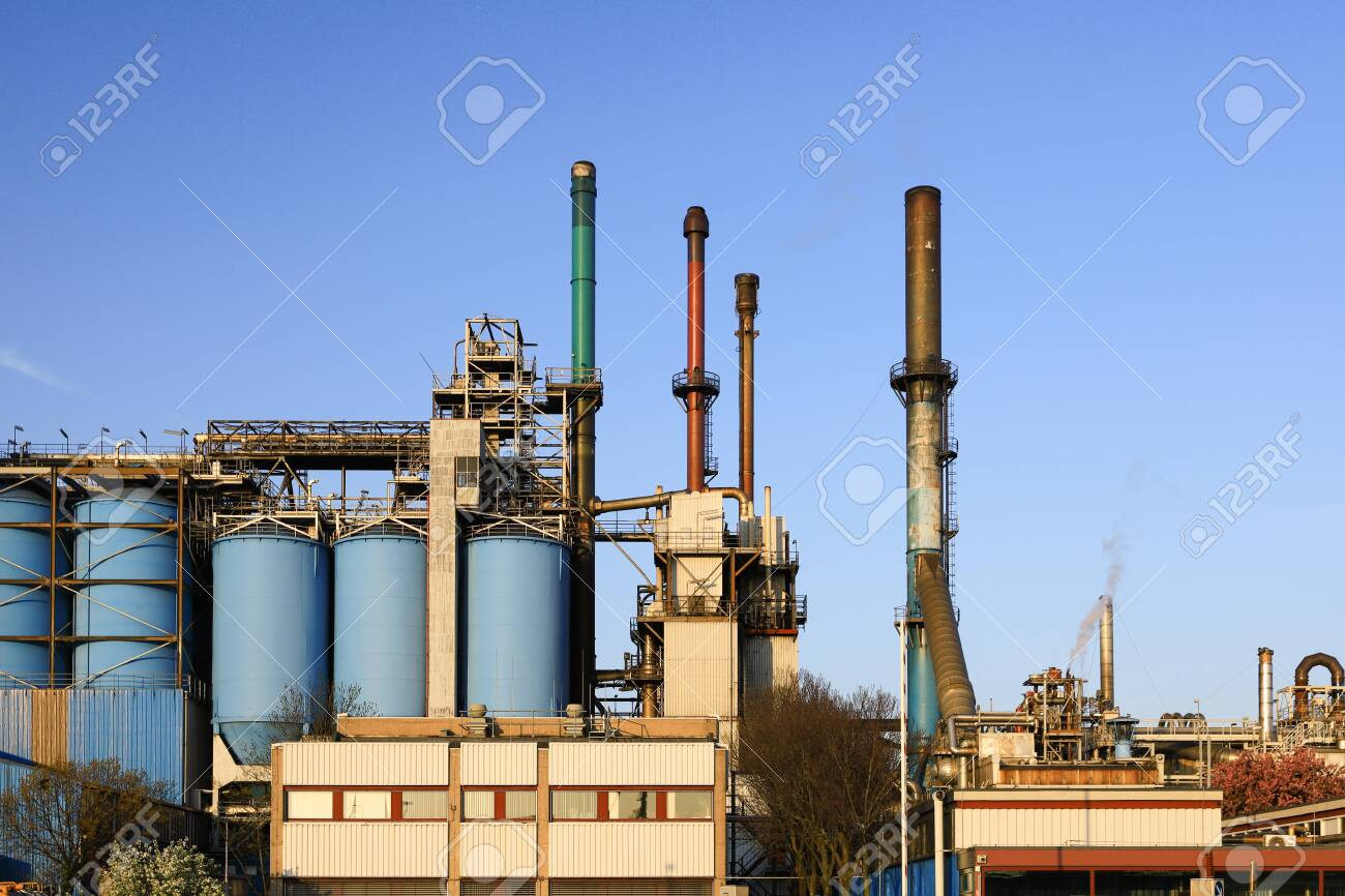 Petrochemical industrial plant power station at sunset, close up of a factory building, - 145254250