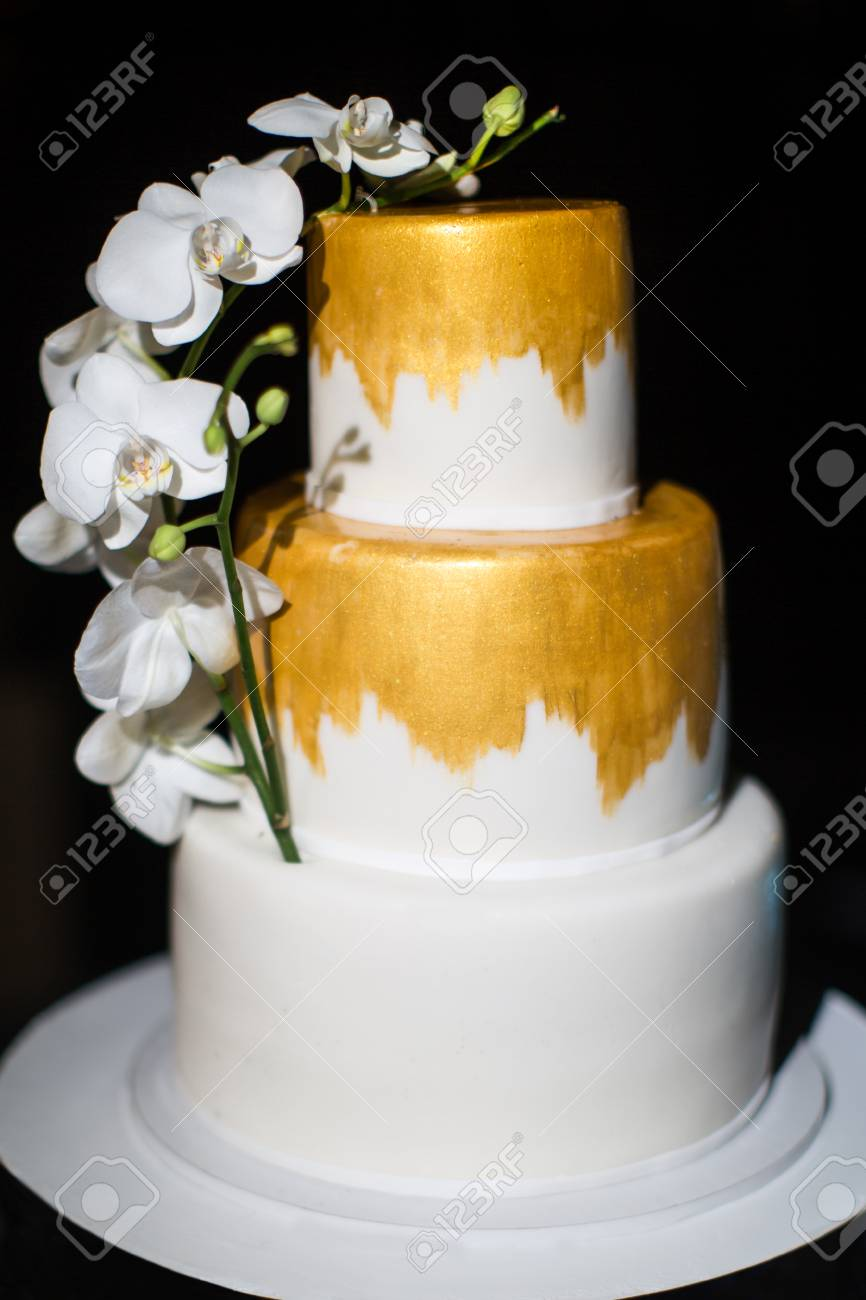 Multi Level Wedding Cake With White Orchids Stock Photo, Picture And ...