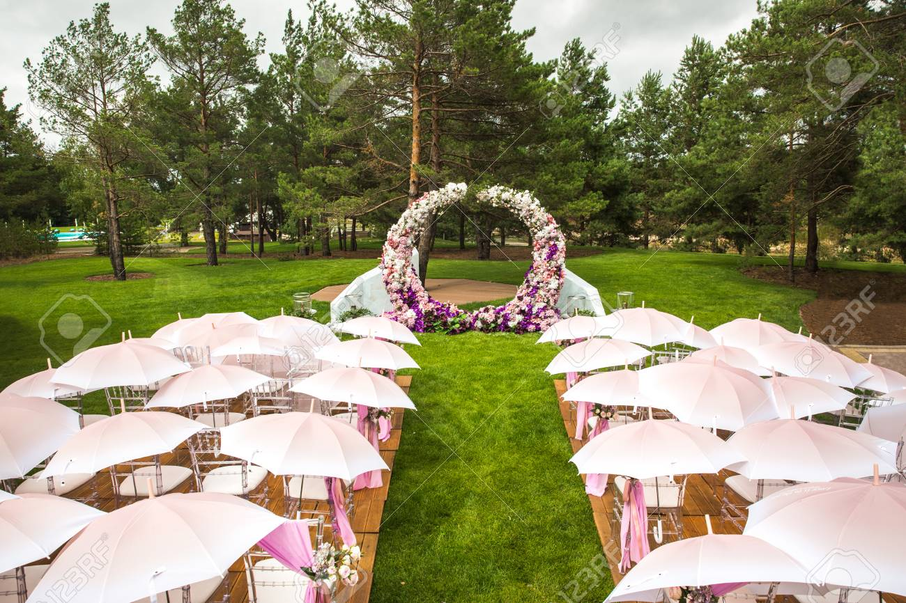 Outdoor Wedding Ceremony With Umbrellas In The Forest