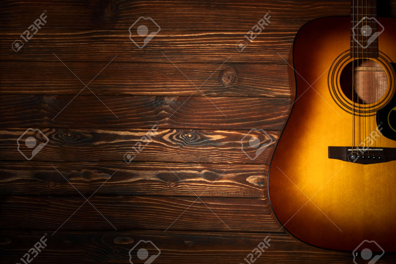 Acoustic guitar on wooden background. Copy space. Top view - 158922759