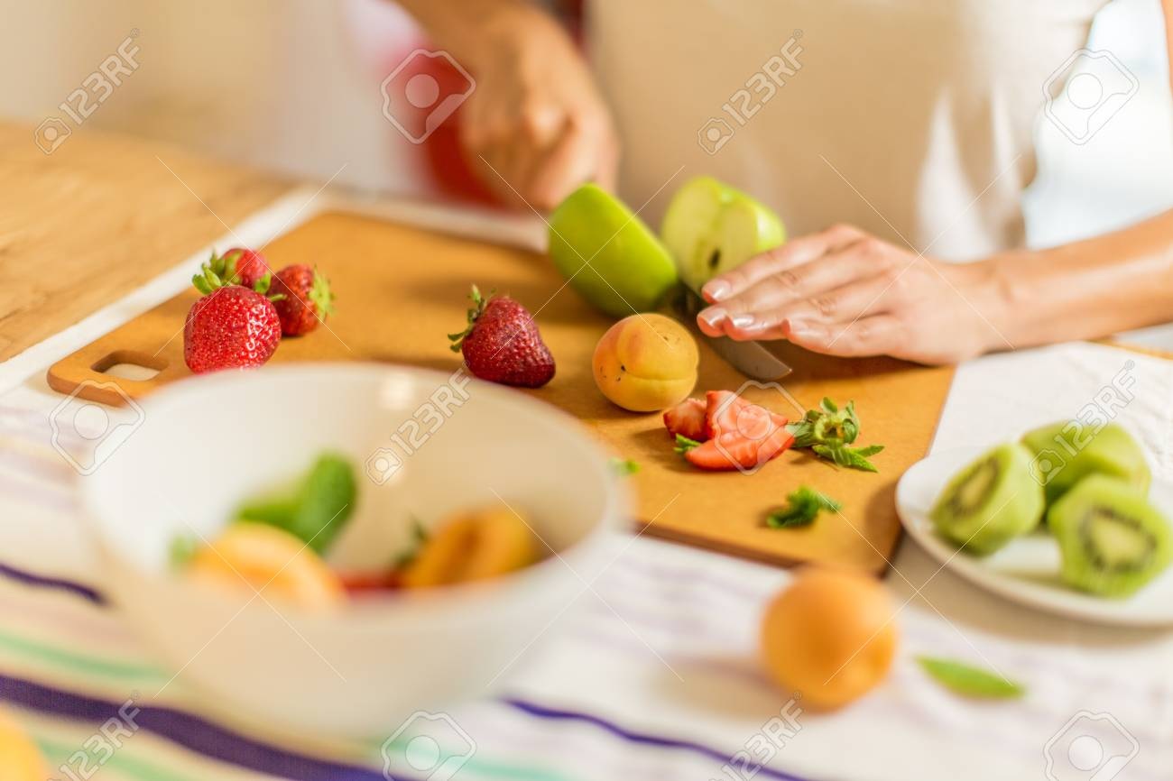 Women Is Cutting Fruits For Fruit Salad Stock Photo, Picture And Royalty Free Image. Image 62123389.