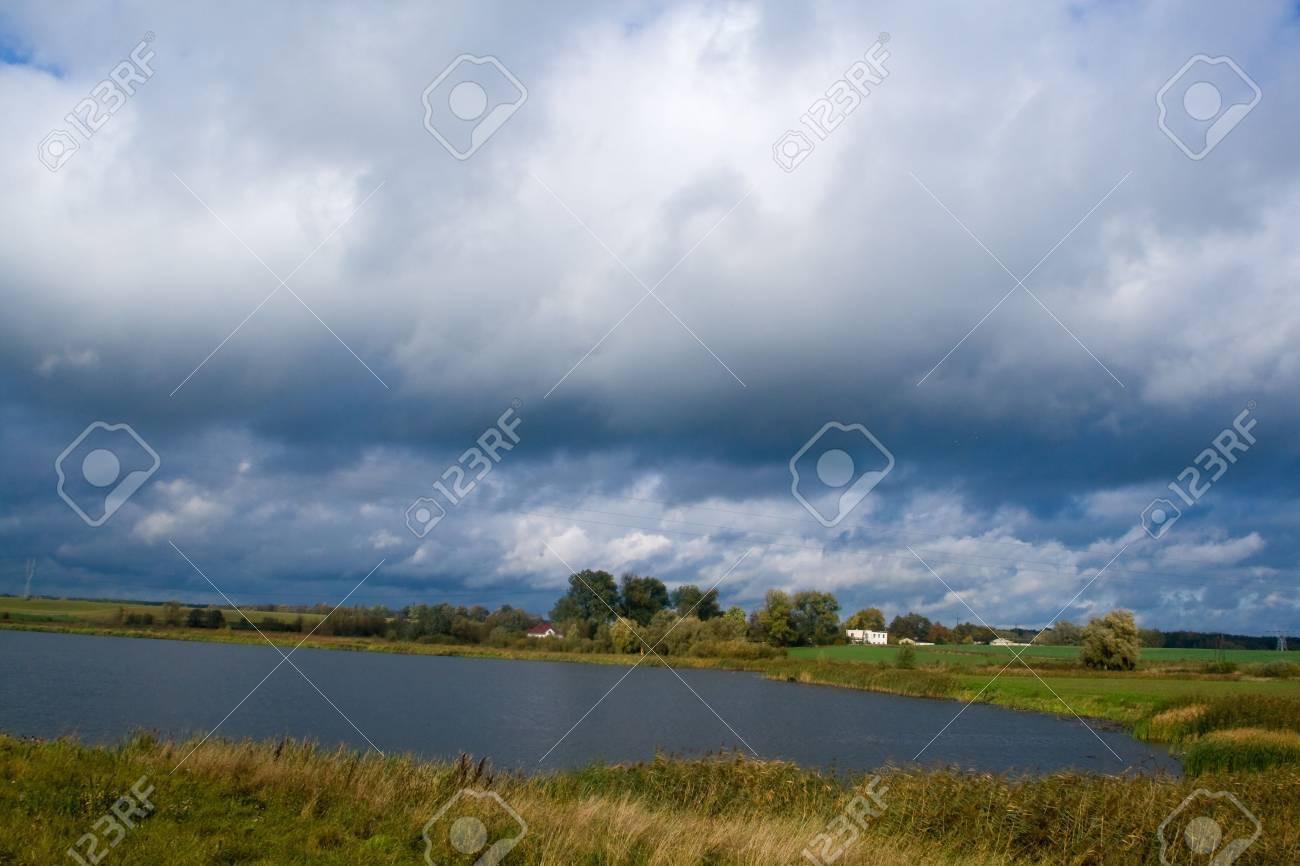 frozen lake during the cold autumn day afternoon Stock Photo - 4122794