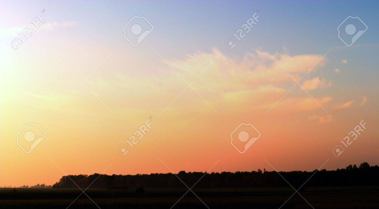 occurring yellow sun behind the clouds on a warm evening Stock Photo - 8137192