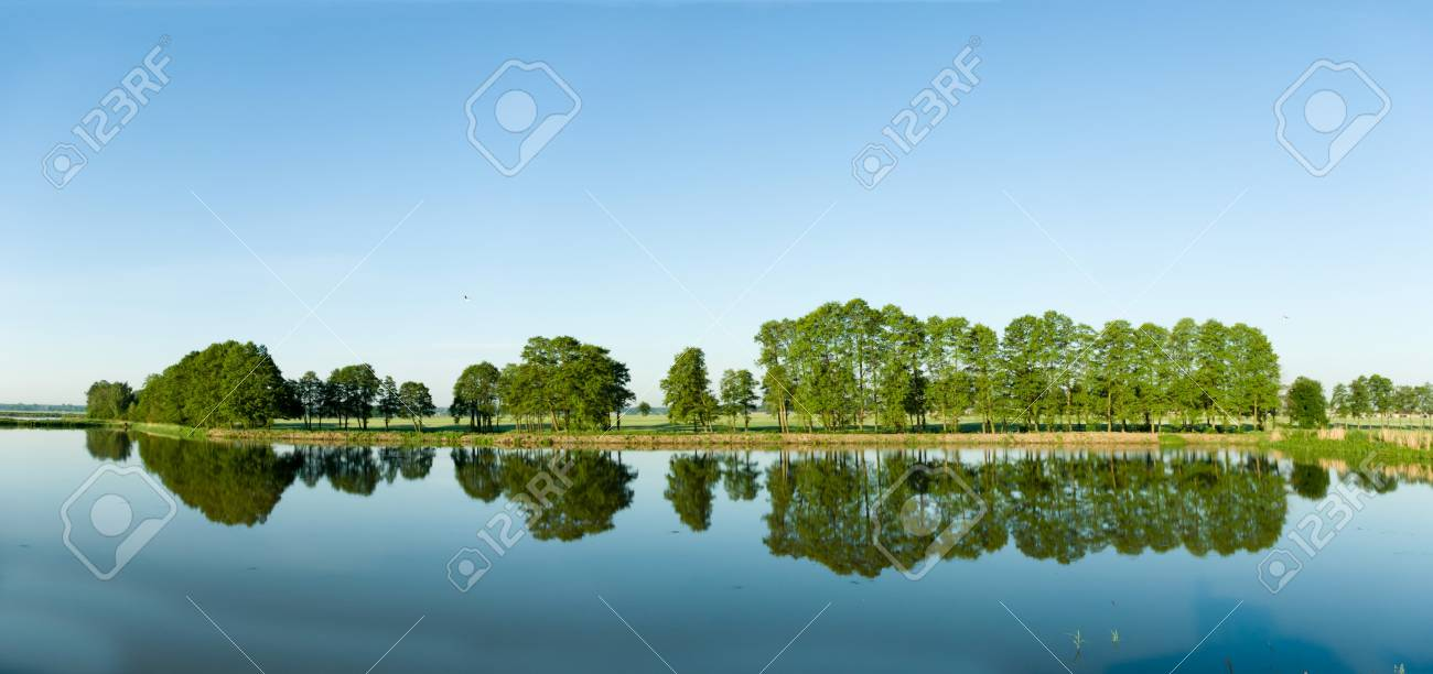 A rural small lake and a green forest Stock Photo - 9660650