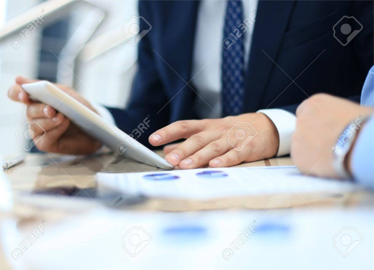 Business adviser analyzing financial figures denoting the progress in the work of the company - 30790208