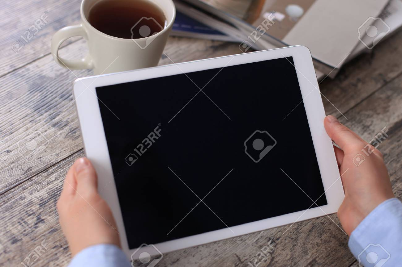Digital tablet computer with isolated screen in female hands over cafe background - 36206573