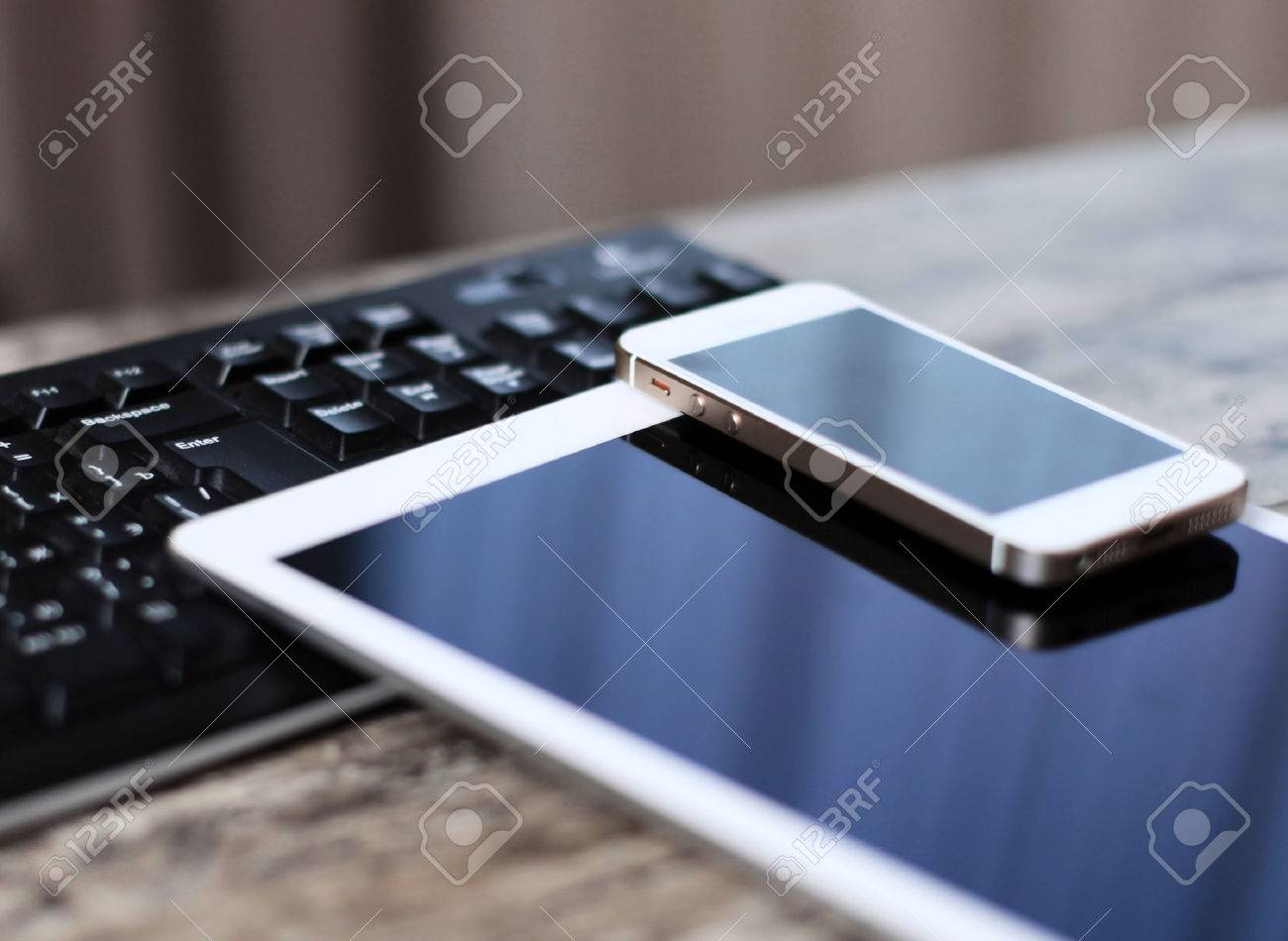 Modern workplace with digital tablet computer and mobile phone - 36503649