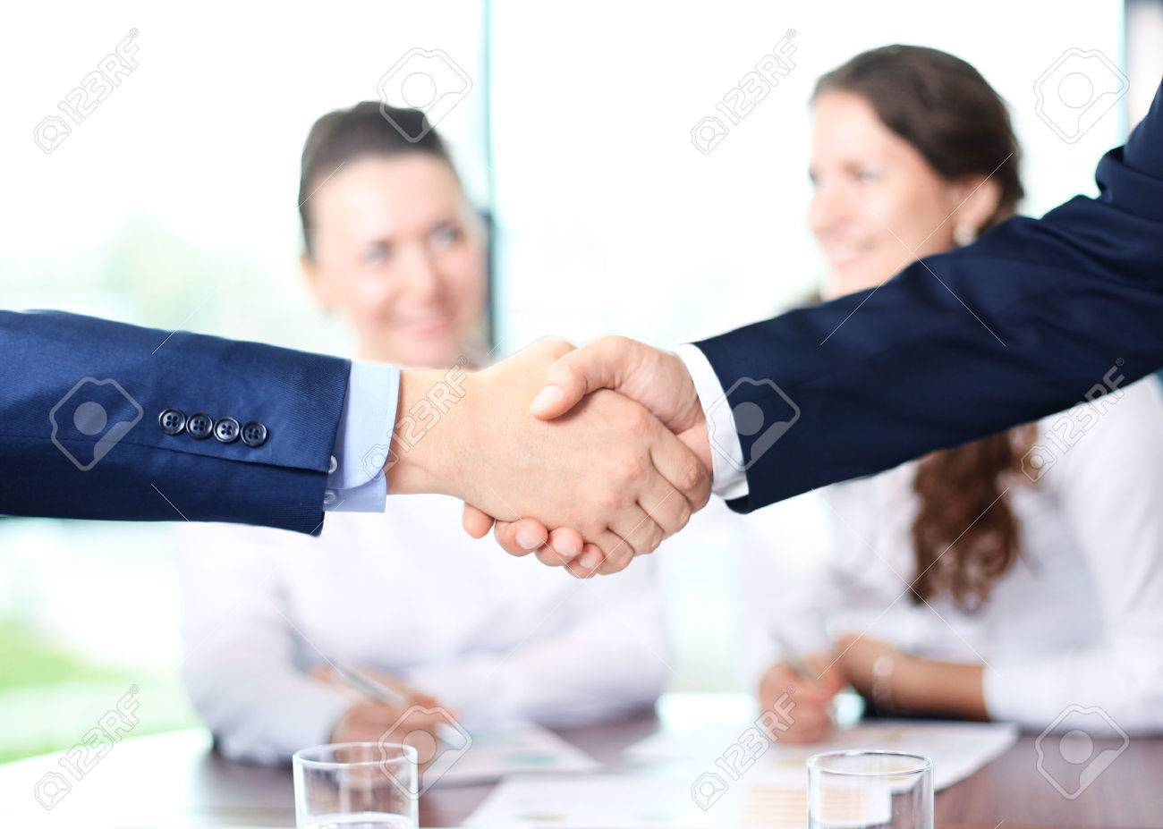 Business people shaking hands, finishing up a meeting - 40549817