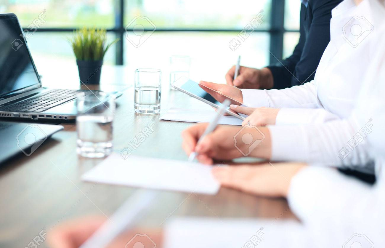 Business adviser analyzing financial figures denoting the progress in the work of the company - 40549595