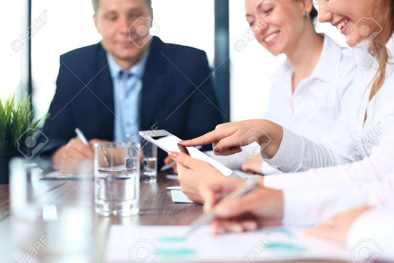 Business adviser analyzing financial figures denoting the progress in the work of the company - 42437106