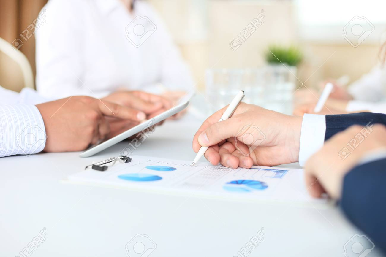 Business adviser analyzing financial figures denoting the progress in the work of the company - 42869423