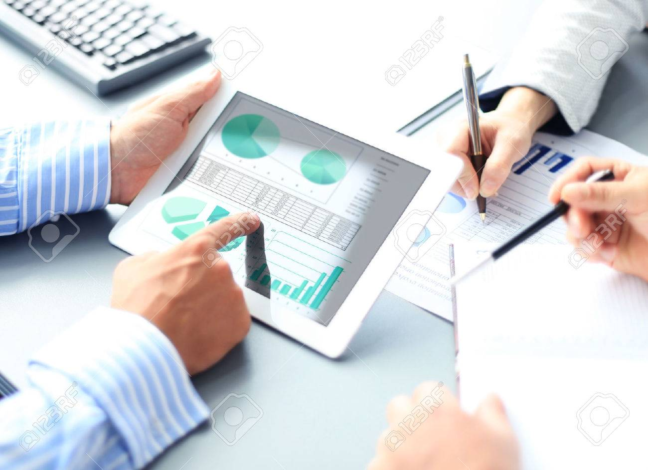 Image of human hand pointing at touchscreen in working environment at meeting - 44557805