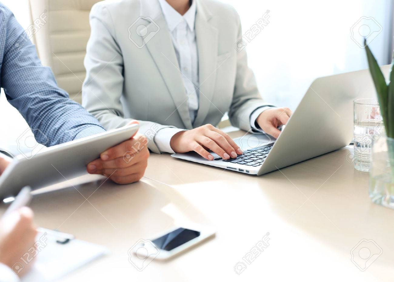 Business adviser analyzing financial figures denoting the progress in the work of the company - 45261419