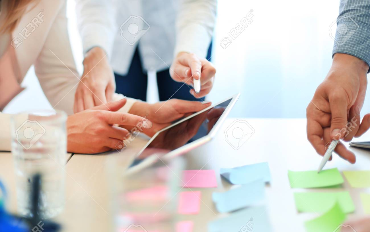 Coworkers discussing the financial status of their business on a digital tablet - 46591727