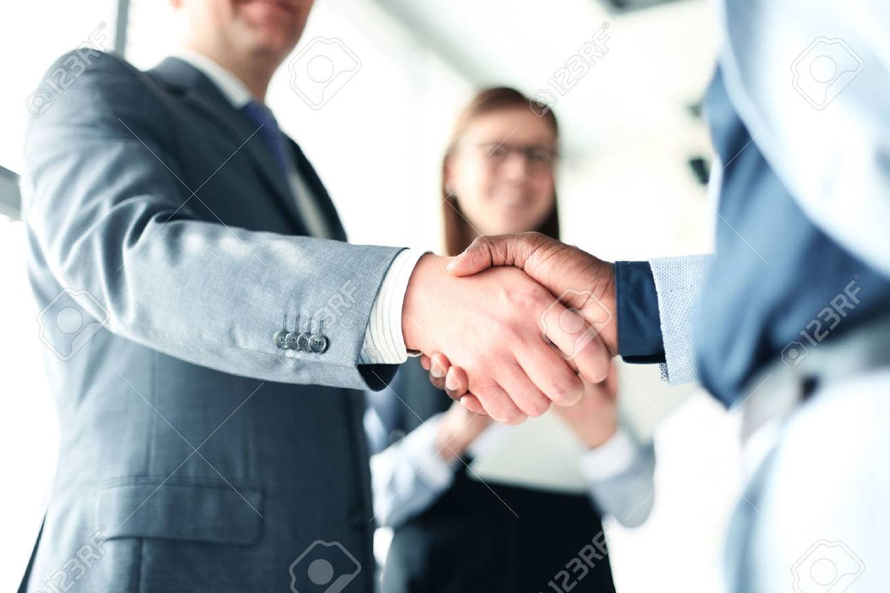 Business people shaking hands, finishing up a meeting - 56732738