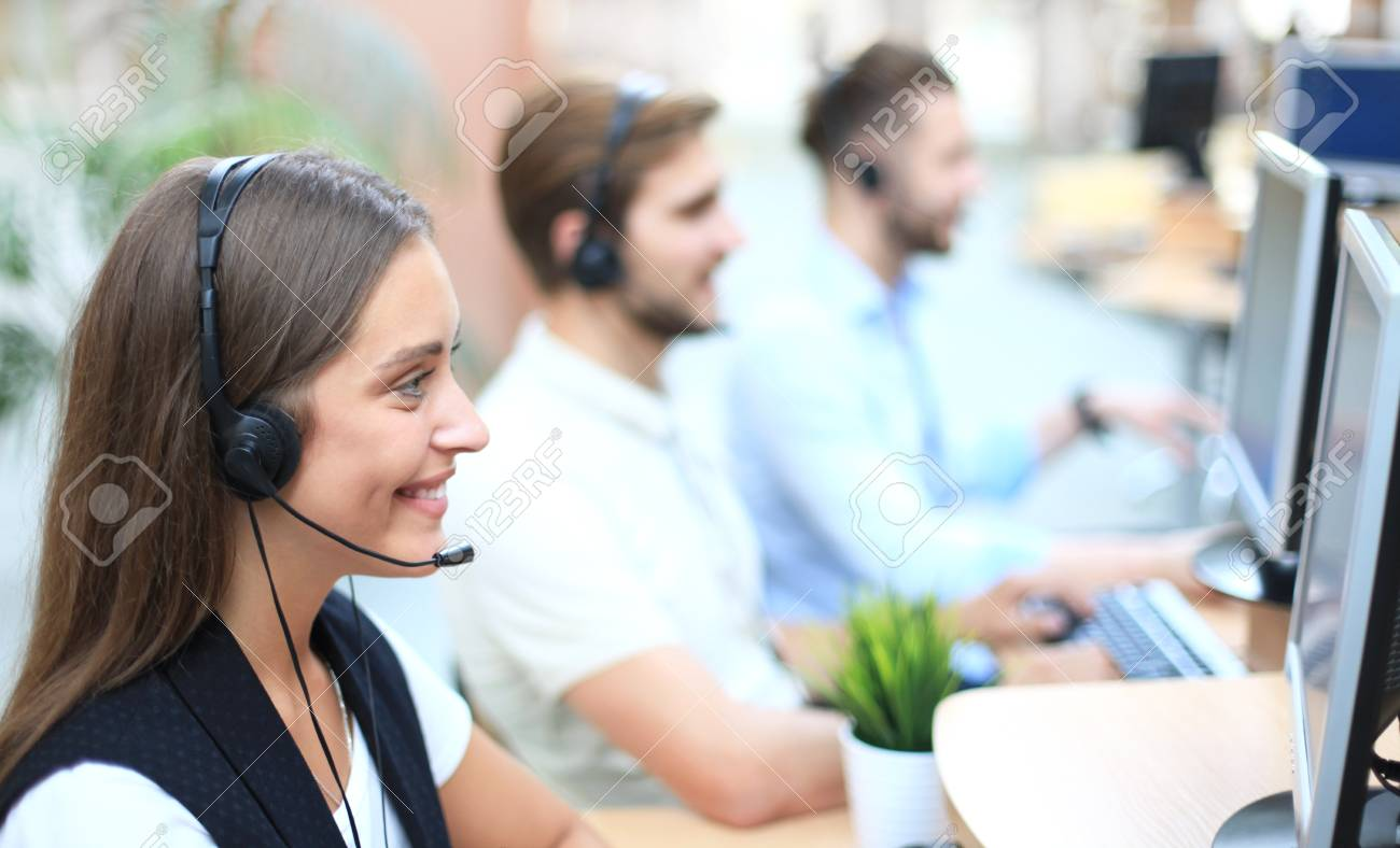 Attractive positive young businesspeople and colleagues in a call center office. - 107405154