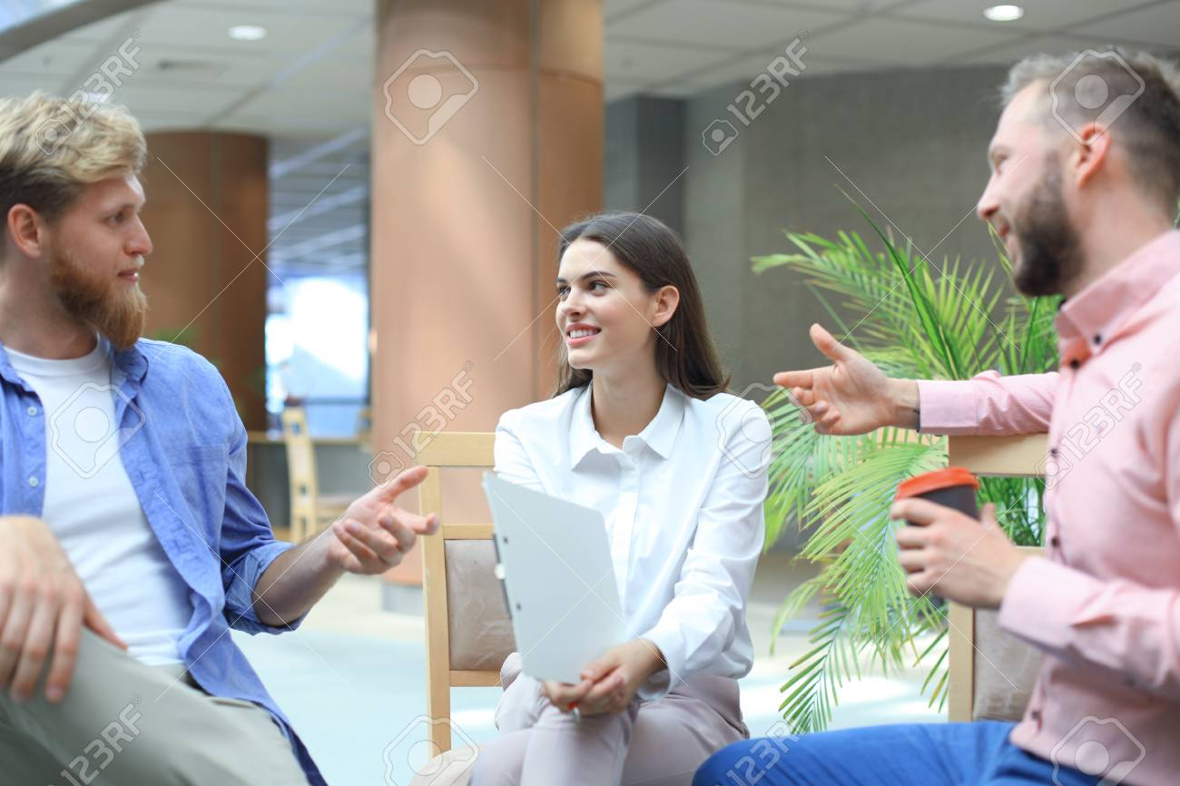 d3c795bb7a5 Young colleagues in smart casual wear working while spending time in the  office. Stock Photo