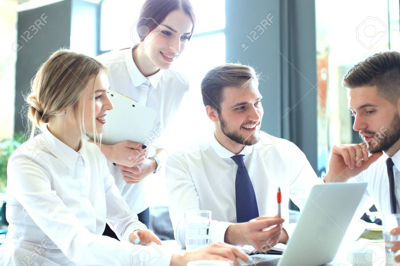 Group of business partners discussing ideas and planning work in office - 121942345