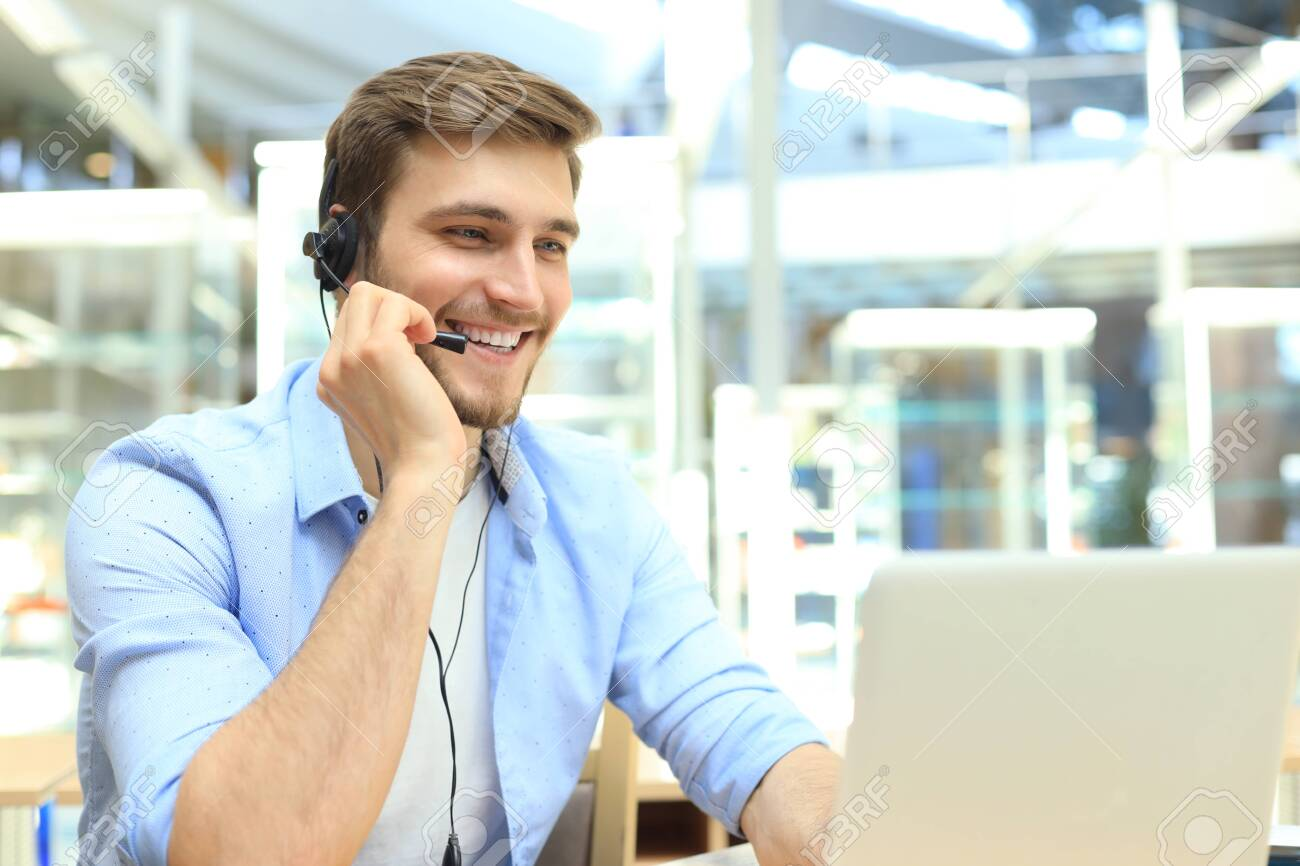 Happy young male customer support executive working in office - 122474531