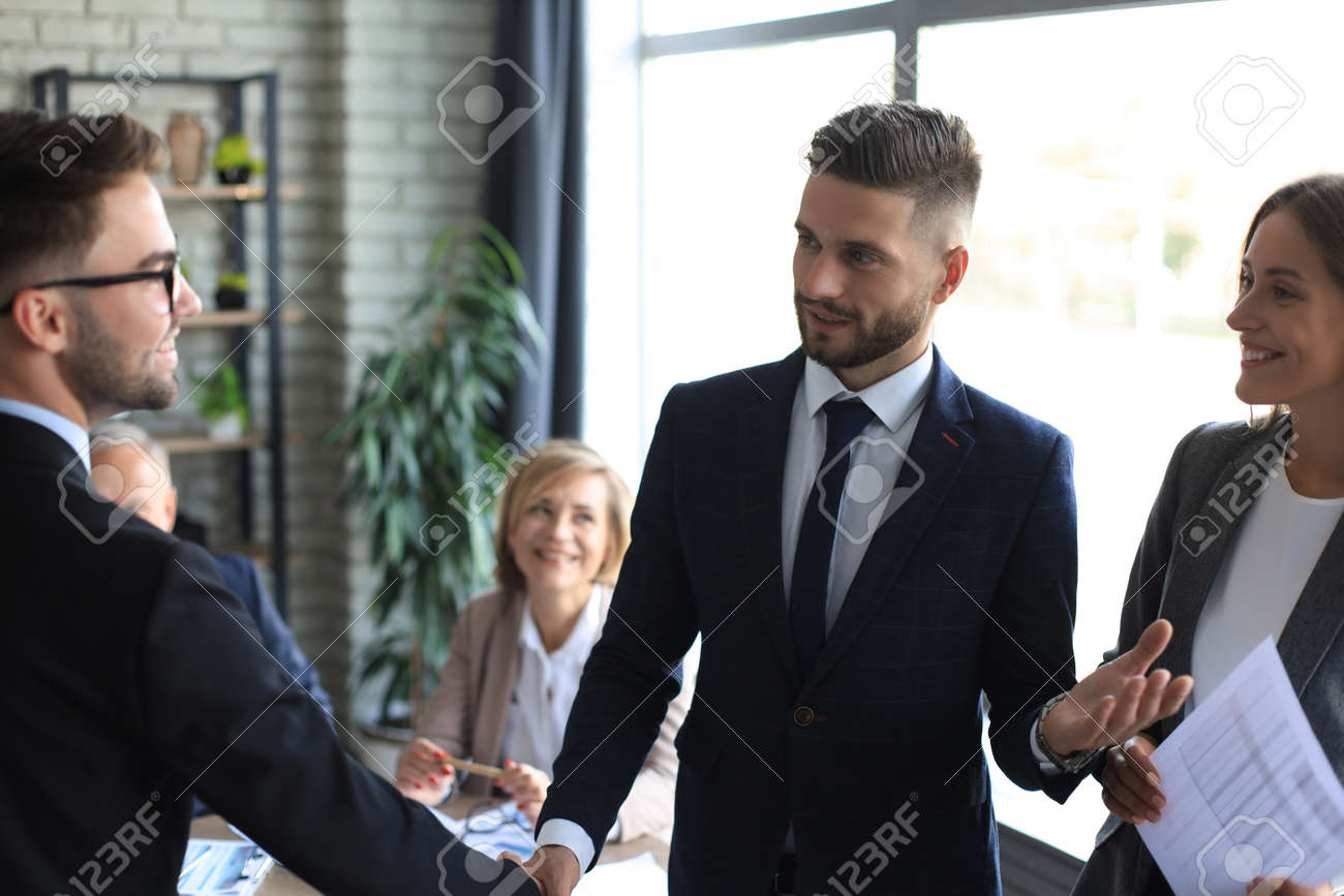 Business people shaking hands, finishing up a meeting - 155578197